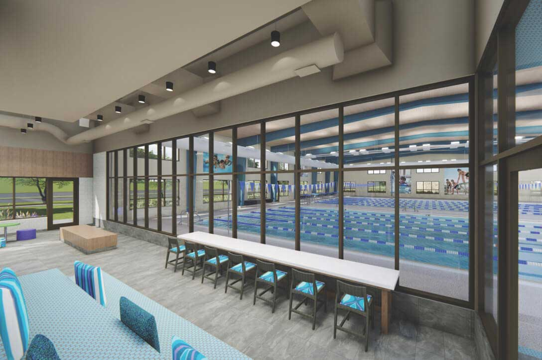 View of stadium seating, additional chairs for viewing the pool and the lap pool