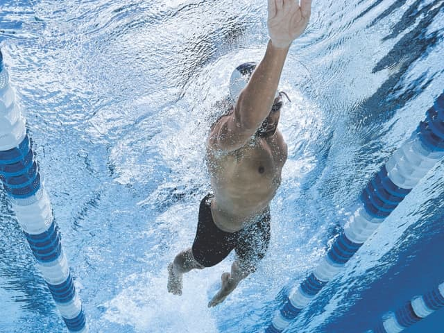 Man performing the freestyle stroke in a lap pool
